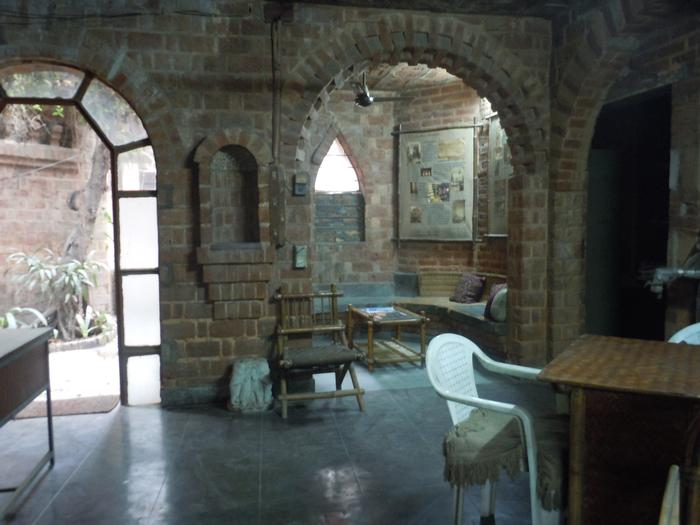 The interior room showing the supporting brick arches framing the entrance and the sitting area