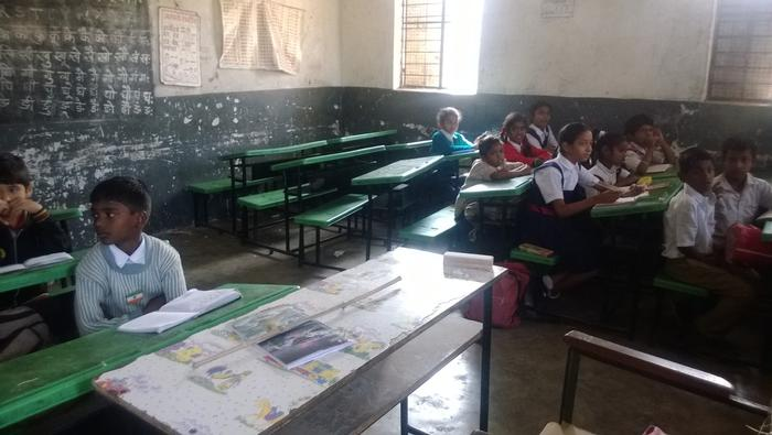 Small, dimly lit classroom of Grade 2 students in the Sarva Shiksha Abhiyan School