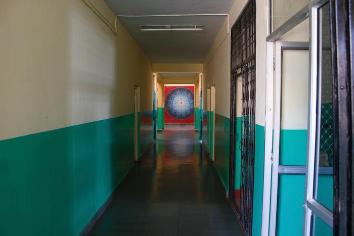 Corridors at NSS culminating in the covered courtyard. Also visible is the collapsible gate on ramp