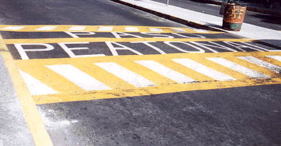 This pedestrian crosswalk provides level access to a bus island at an inter-modal transfer center in Mexico City.<br>Photo by T. Rickert, courtesy of DFID (UK) and TRL (UK).