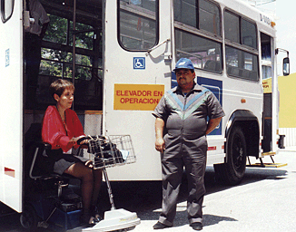 In addition to a wheelchair lift, this bus in Mexico City has a retractable step beneath the front entrance.