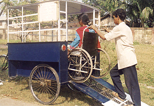 This accessible bicycle rickshaw in India has a rear door which serves as a ramp.<br>Photo courtesy of Bikash Bharati Welfare Society and Lalita Sen.