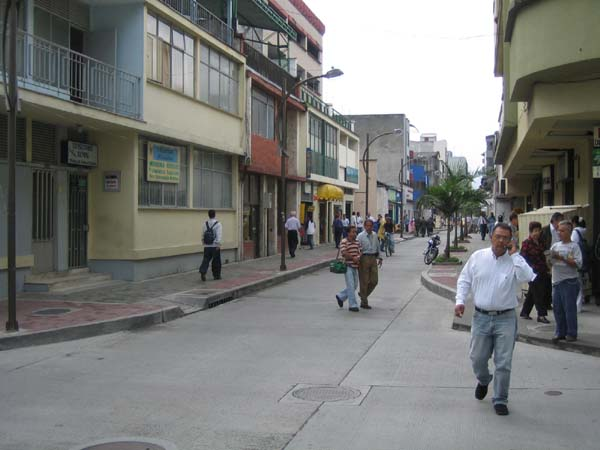 Although most BRT busways are on broad thoroughfares, this exclusive single-direction bus lane nearing completion in Pereira illustrates that BRT systems can sometimes be built on narrow streets.<br>This and above photo by T. Rickert courtesy of World Bank