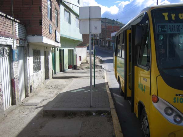 Even when bus stops are not accessible to wheelchair users, access for seniors and others with disabilities can be enhanced by a level all-weather pad even in the absence of paved sidewalks. The photo is from a TransMilenio feeder route in Bogotá.<br>This and above photo by T. Rickert courtesy of World Bank.