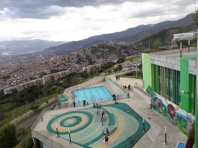 <strong>UVA Nuevo Occidente, </strong>Medellín, Colombia. Public and community spaces including swimming pool, dressing rooms, and recreational terrace; a ballroom, toy library, classroom workshop, cinema auditorium and children's playground; multiple classrooms, administrative offices, commercial premises and viewing terrace and, in addition to a multi-purpose Coliseum, synthetic court and urban gym. See also: <a href='https://www.lafargeholcimfoundation.org/media/news/projects/a-new-icon-of-community-empowerment-in-medellin-uva-de-la-imagin'>https://www.lafargeholcimfoundation.org/media/news/projects/a-new-icon-of-community-empowerment-in-medellin-uva-de-la-imagin</a>  (Photo: Benard Acellam)